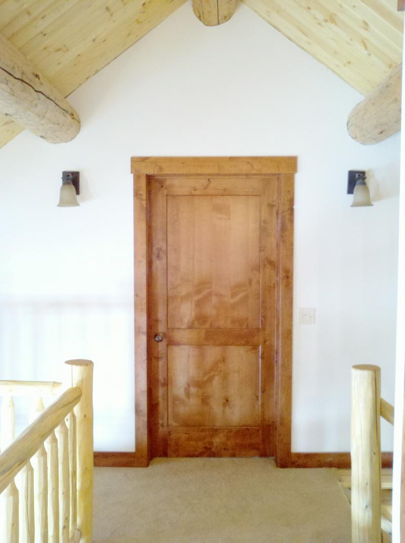 2 Knotty Alder Two Panel Door With Flat Panels