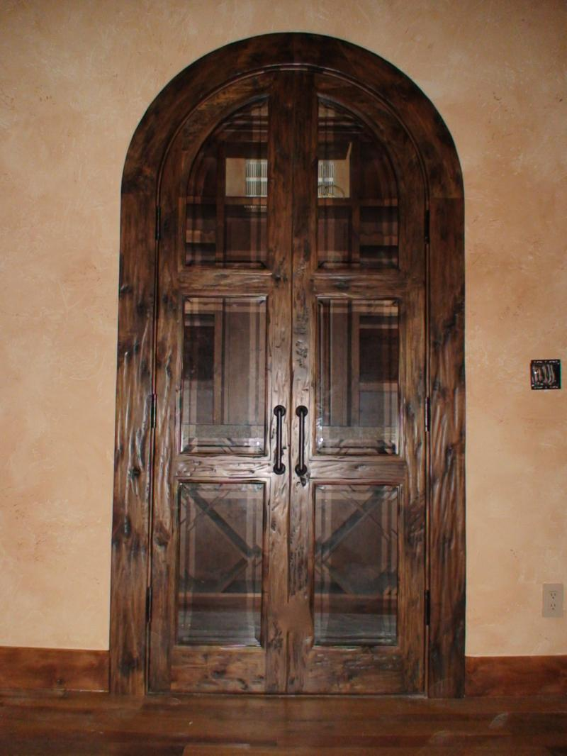 True arch double doors with heavy distress.