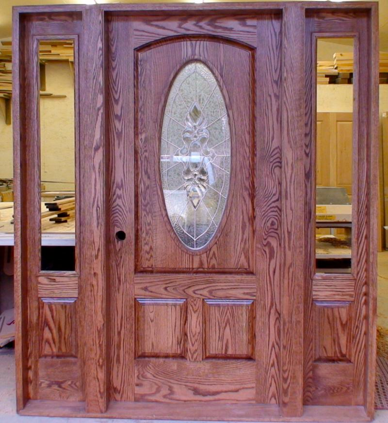 Oak entry with oval art glass
