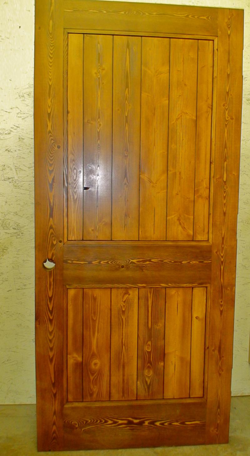 Fir two panel plank style door with applied moulding.