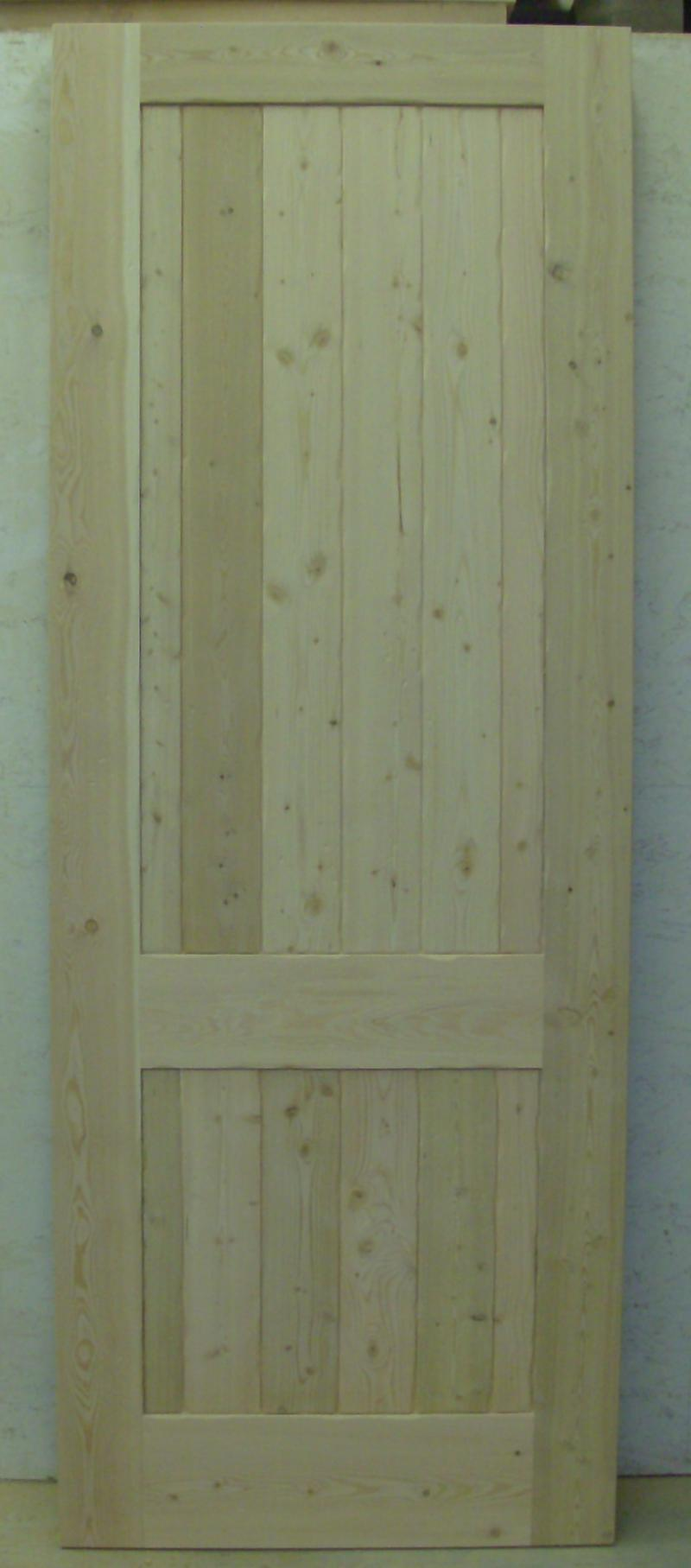 Fir two panel plank style door with medium distress.